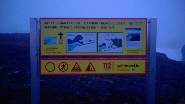 Kirkjufjara beach, warning sign