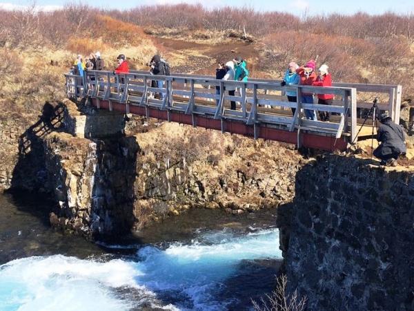 Travellers viewing Brúarfoss